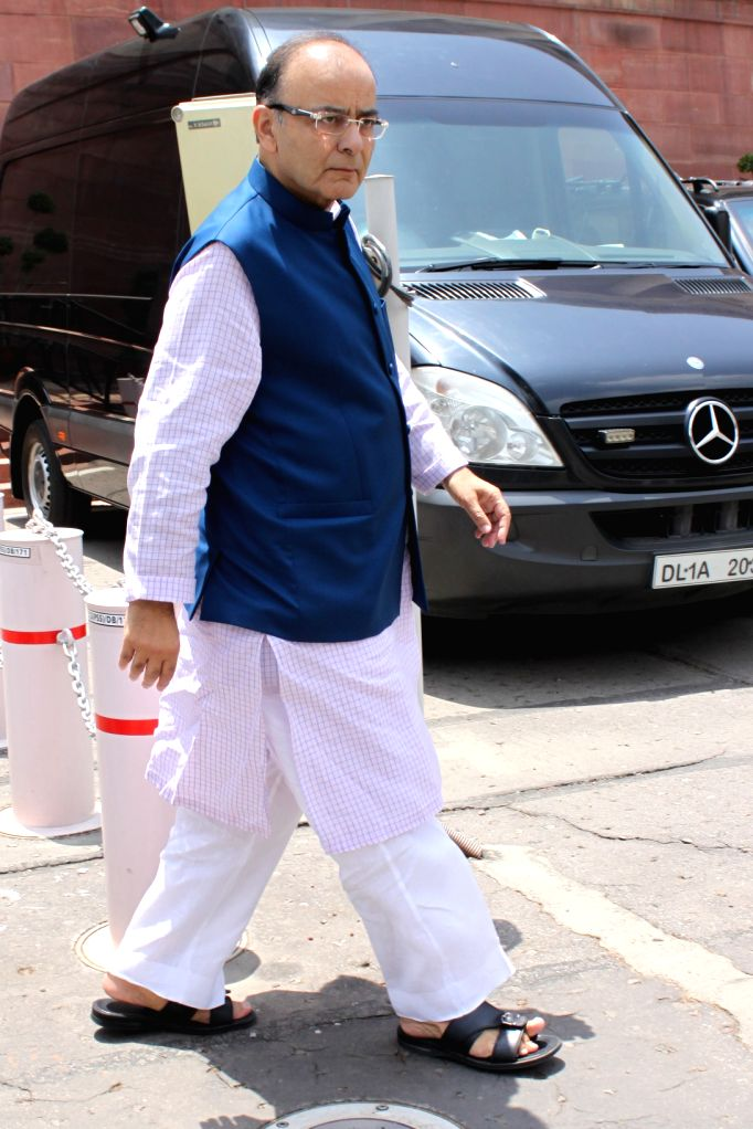 Union Minister for Finance, Corporate Affairs and Information and Broadcasting Arun Jaitley arrives to attend an all party meeting at Parliament House in New Delhi on Aug 3, 2015. - Arun Jaitley