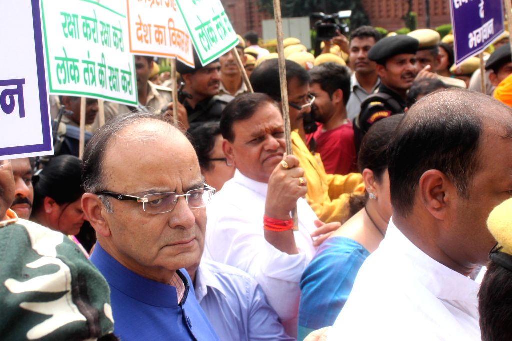 Union Minister for Finance, Corporate Affairs, and Information and Broadcasting Arun Jaitley participates in `Save Democracy` rally at Vijay Chowk  in New Delhi, on Aug 13, 2015. - Arun Jaitley