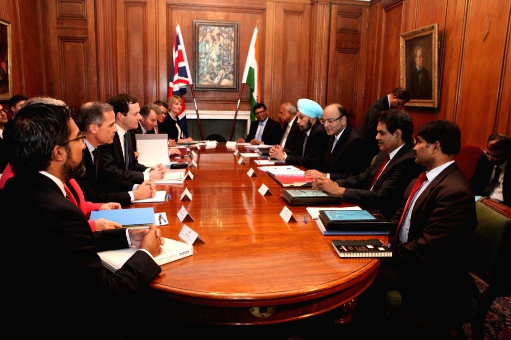 Union Minister for Finance, Corporate Affairs, and Information and Broadcasting Arun Jaitley and Britain's Chancellor of the Exchequer George Osborne during the 8th India-UK Economic and ... - Arun Jaitley