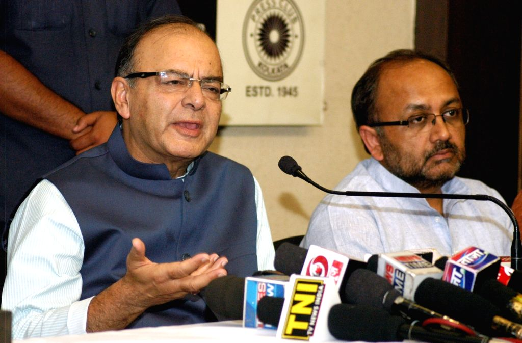 Union Minister for Finance, Corporate Affairs, and Information and Broadcasting Arun Jaitley addresses a press conference in Kolkata on April 10, 2016. - Arun Jaitley