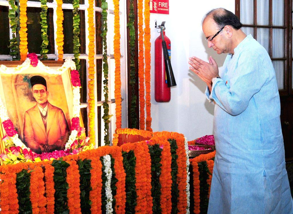 Union Minister for Finance, Corporate Affairs and Information and Broadcasting Arun Jaitley pays homage to Swatantryaveer Vinayak Damodar Savarkar, on his birth anniversary, at Parliament ... - Arun Jaitley