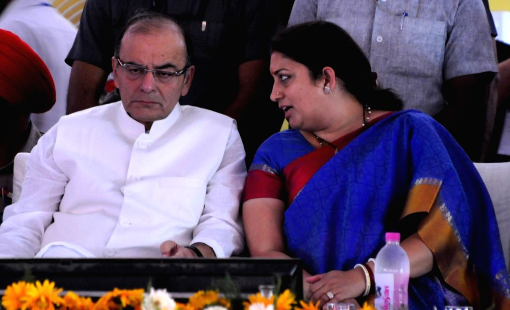 Union Minister for Finance, Corporate Affairs, and Information and Broadcasting Arun Jaitley and Union HRD Minister Smriti Irani during foundation stone laying ceremony of IIM in Manawala ... - Smriti Irani and Arun Jaitley
