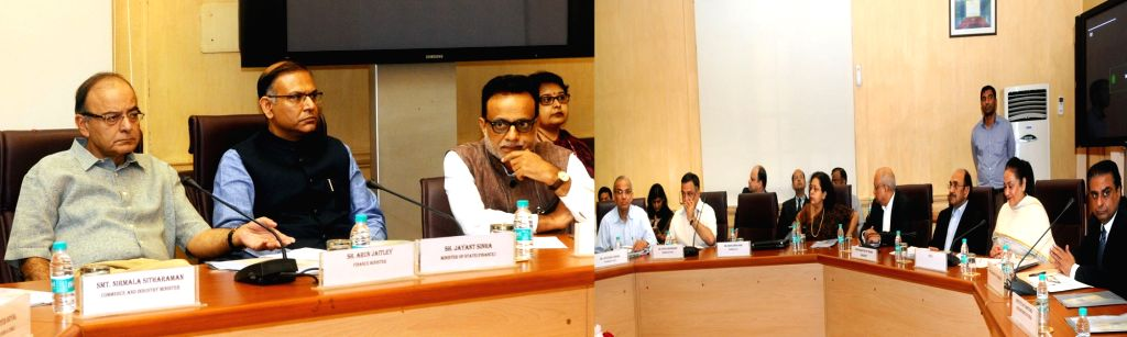 Union Minister for Finance, Corporate Affairs and Information and Broadcasting Arun Jaitley during a meeting with the various Chambers of Commerce & Association of Professionals ... - Arun Jaitley and Jayant Sinha