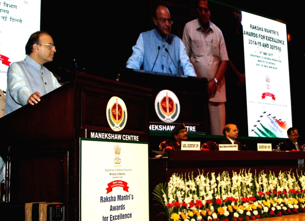 Union Minister for Finance, Corporate Affairs and Defence Arun Jaitley addresses at the Raksha Mantri's Awards function for Excellence for the years 2014-15 and 2015-16, in New Delhi on ... - Arun Jaitley