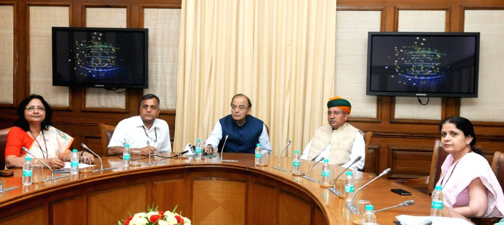 Union Minister for Finance, Corporate Affairs and Defence Arun Jaitley launch the new website of Department of Expenditure in New Delhi on June 2, 2017. Also seen Minister of State for ... - Arun Jaitley