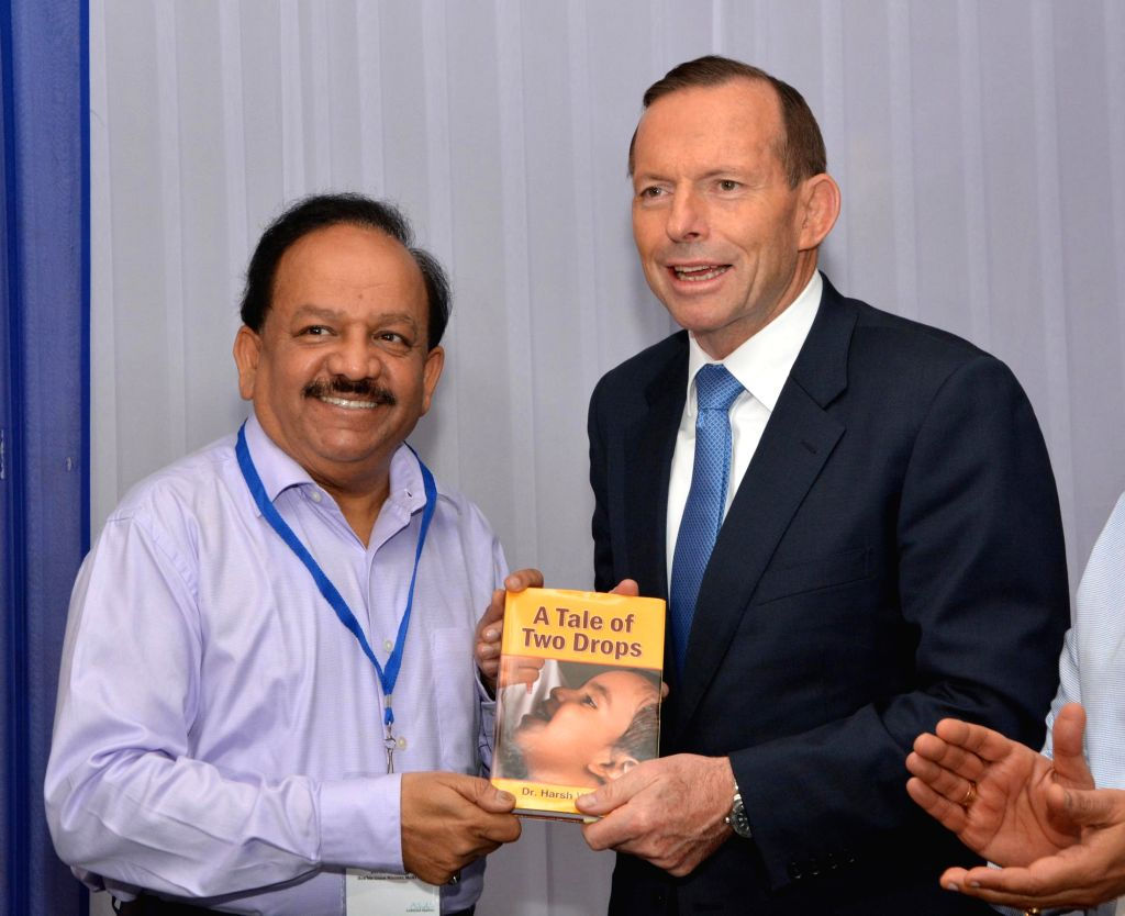 Union Minister for Health and Family Welfare, Dr. Harsh Vardhan presents his book `A Tale of Two Drops` to the Australian Prime Minister Tony Abbott in New Delhi on Sept 5, 2014. India was declared .. - Tony Abbott