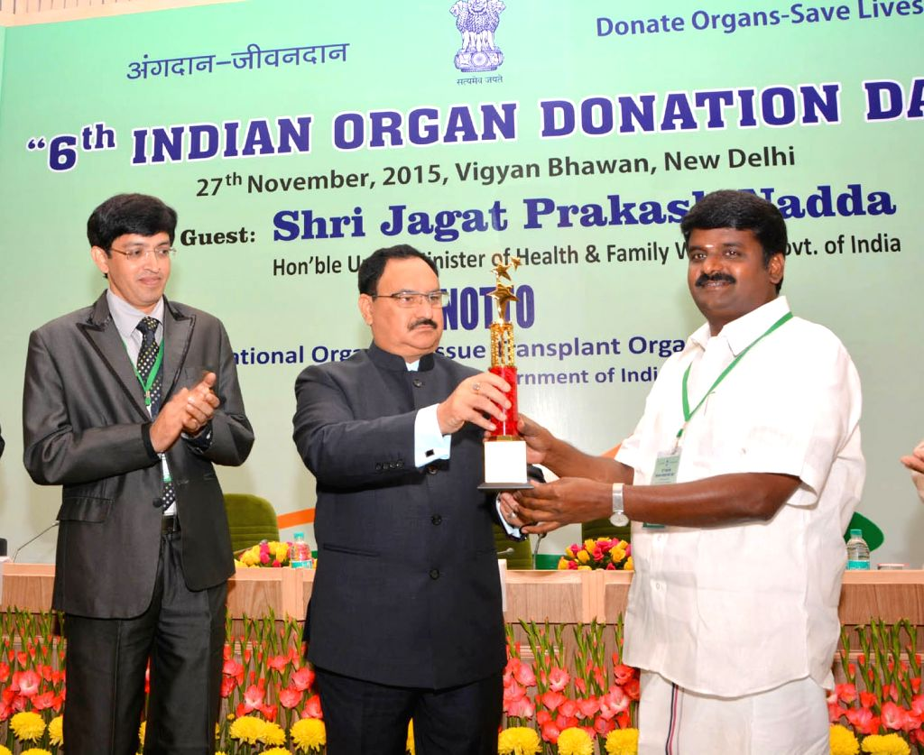 Union Minister for Health and Family Welfare J.P. Nadda presents the award to the Health Minister of Tamil Nadu, C. Vijaya Baskar, for best state award in the area of organ donation and ...