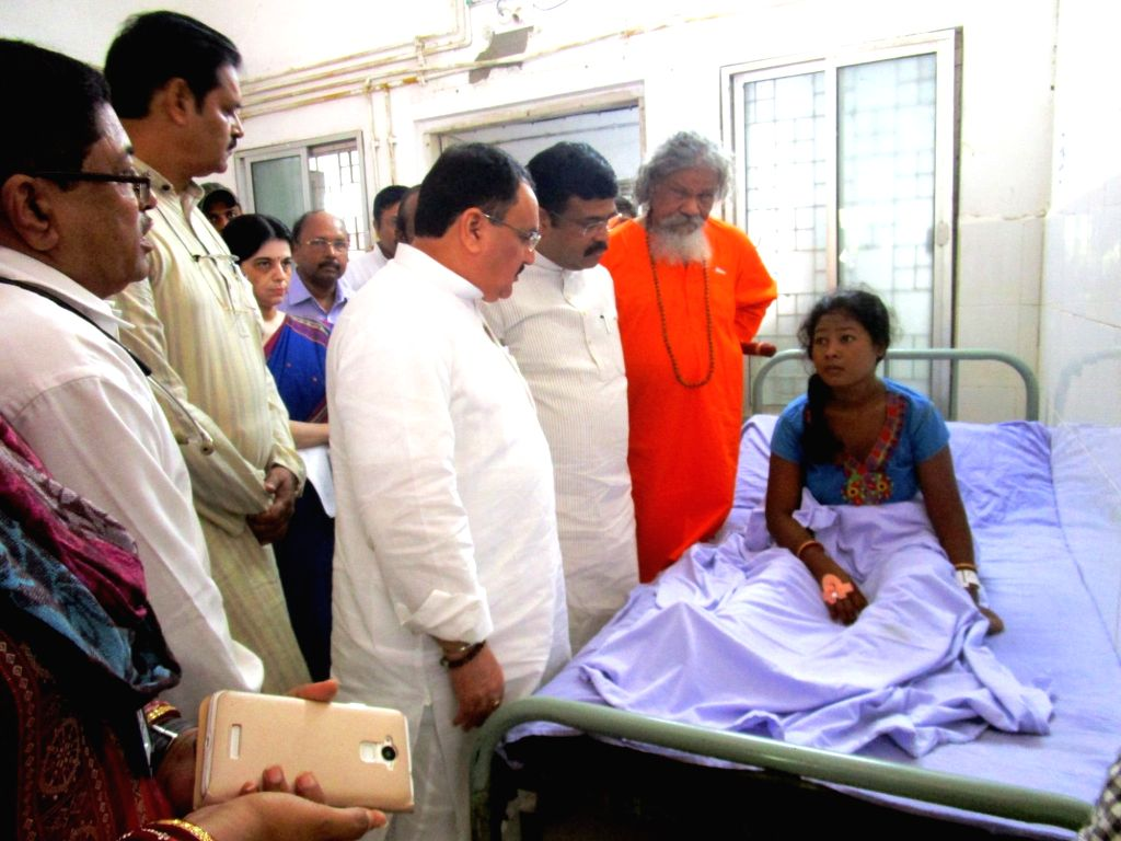 Union Minister for Health & Family Welfare J.P. Nadda interacts with the victims of SUM Hospital fire tragedy, at Capital Hospital, in Bhubaneswar on Oct 19, 2016. Also seen Union ...