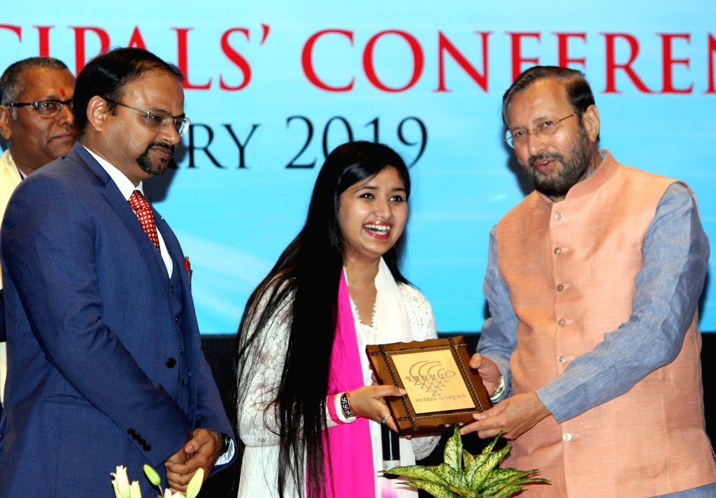 Union Minister for Human Resource Development Prakash Javadekar presents a memento to Ishita Vishwakarma after her performance at the KVS (Kendriya Vidyalayas Sangathan) and NVS (Navodaya ...