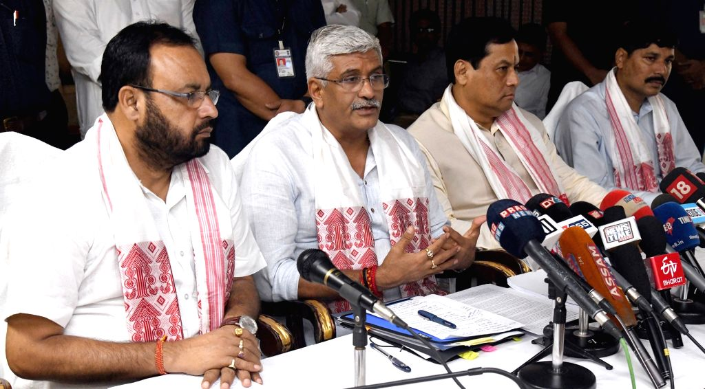 Union Minister for Jal Shakti Gajendra Singh Shekhawat addresses a press conference after taking stock of the flood situation in Assam, at Guwahati on July 16, 2019. Also seen Assam Chief ... - Sarbananda Sonowal