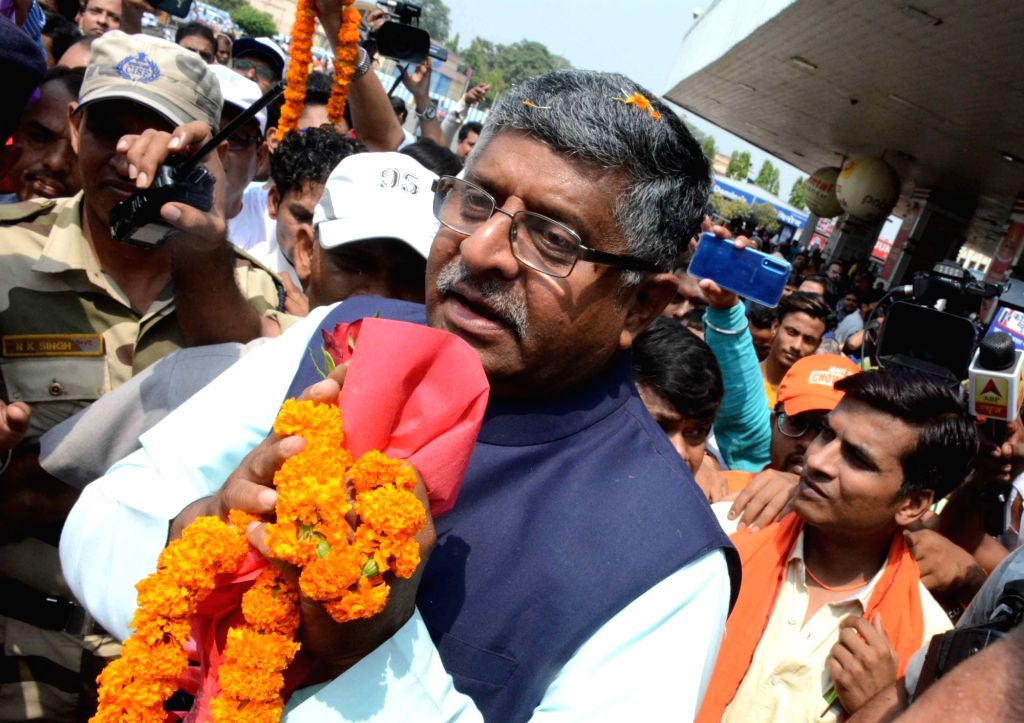 Union Minister for Law and Justice; Communications and Electronics and Information and Technology Ravi Shankar Prasad receives warm welcome by BJP workers on his arrival at the Jay Prakash ...