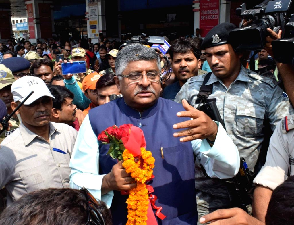 Union Minister for Law and Justice; Communications and Electronics and Information and Technology Ravi Shankar Prasad receives a warm welcome by BJP workers on his arrival at the Jay Prakash ...