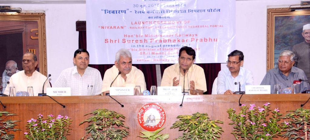 Union Minister for Railways Suresh Prabhakar Prabhu addresses at the launch of the NIVARAN portal (An online system for redressal of service related grievance of serving and former railway ... - Suresh Prabhakar Prabhu and Manoj Sinha