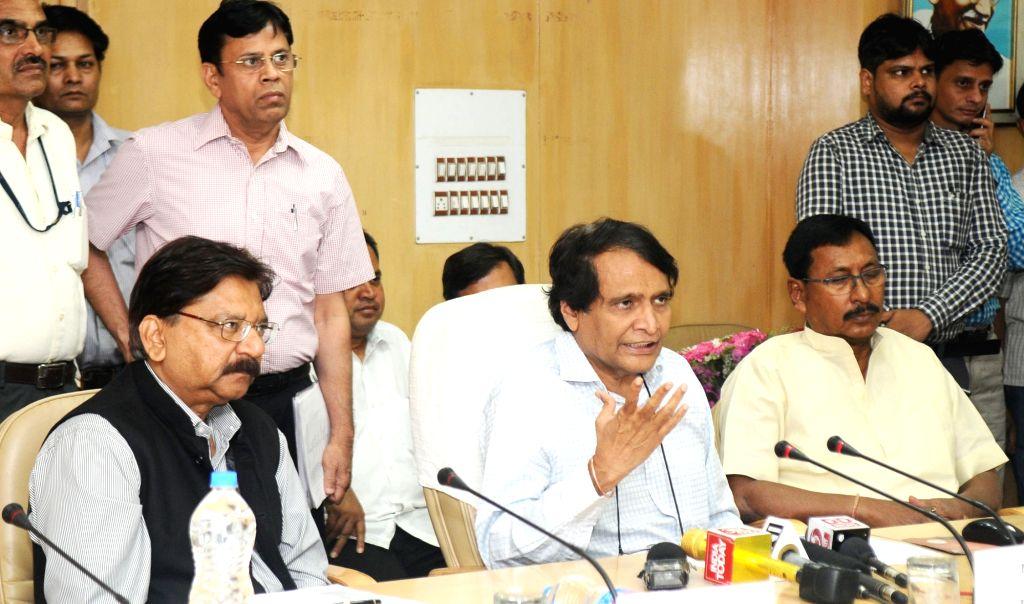 Union Minister for Railways Suresh Prabhu addresses at the inauguration of the various Passenger Amenities at various Mumbai Suburban Railway Stations like Skywalk, Escalator, Foot over ... - Suresh Prabhu