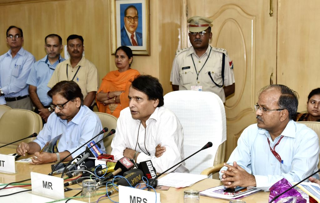 Union Minister for Railways Suresh Prabhu addresses at the launch of the Mission Retro-Fitment in New Delhi on June 13, 2017. Also seen Railway Board member (Traffic) Mohd Jamshed and the ... - Suresh Prabhu and Ravindra Gupta