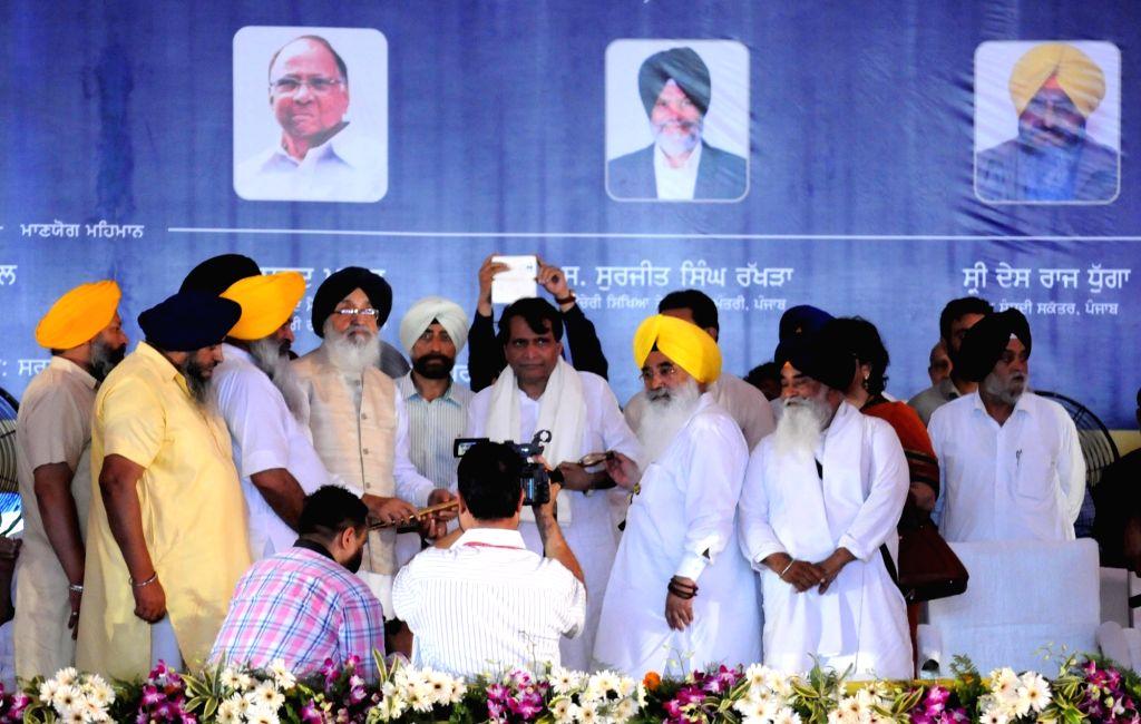 Union Minister for Railways Suresh Prabhu and Punjab Chief Minster Parkash Singh Badal during the inauguration of Bhagat Namdev University College at Ghuman in Gurdaspur district of Punjab ... - Suresh Prabhu