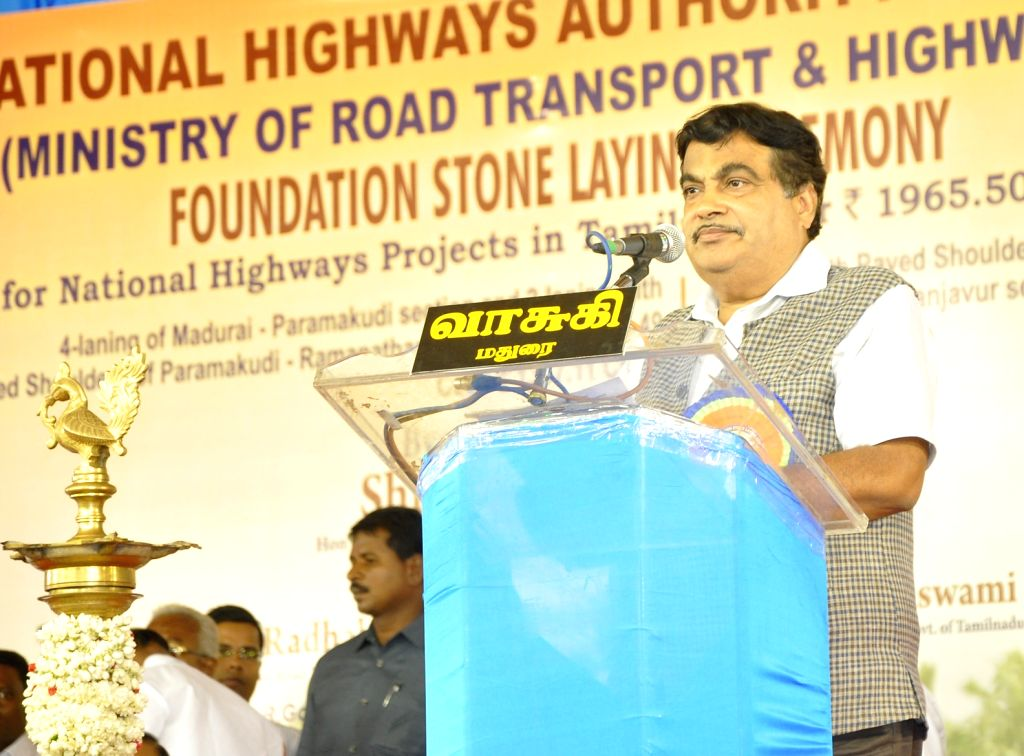 Union Minister for Road Transport and Highways and Shipping Nitin Gadkari addresses at the foundation stone laying ceremony for 4 laning of Madurai - Paramakudi section, 2 laning of ...