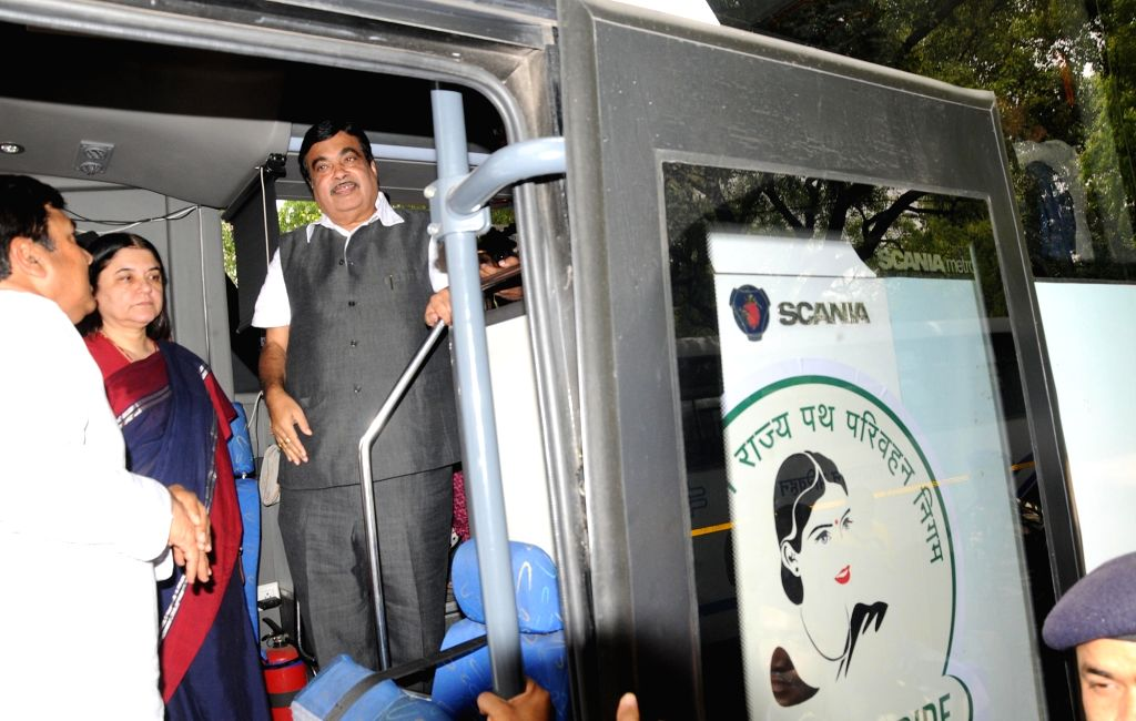 Union Minister for Road Transport & Highways and Shipping Nitin Gadkari during launch of buses under Nirbhaya Scheme, in New Delhi on May 25, 2016. Also seen Union Minister for Women ... - Development Maneka Gandhi