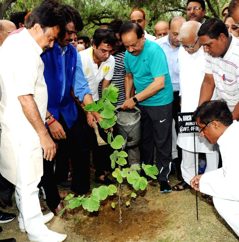 Union Minister for Science and Technology, Earth Sciences and Environment, Forest and Climate Change, Dr. Harsh Vardhan leading a plantation drive to celebrate 'Van Mahotsav' at Paschim ...