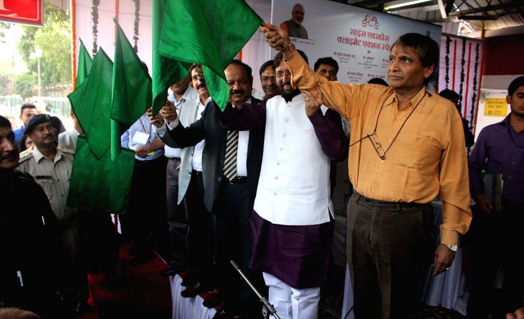 Union Minister for Science and Technology Harsh Vardhan, Union Environment Minister Prakash Javadekar and Union Railway Minister Suresh Prabhakar Prabhu flag-off Science Express - Climate ... - Prakash Javadekar and Suresh Prabhakar Prabhu