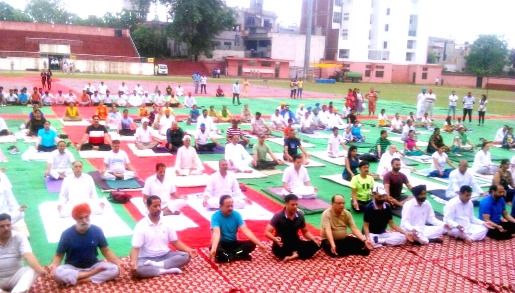 Union Minister for Science & Technology, Earth Sciences and Environment, Forest & Climate Change, Dr. Harsh Vardhan practices Yoga Asans -postures- on International Yoga Day in ...