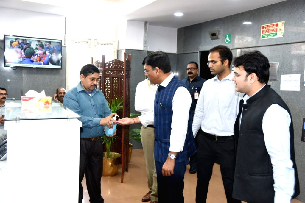 Union Minister for Shipping and for Chemical and Fertilizers, Mansukh L. Mandaviya sanitising hands at a meeting with other Ministers to tackle COVID-19 (coronavirus), in New Delhi on ...