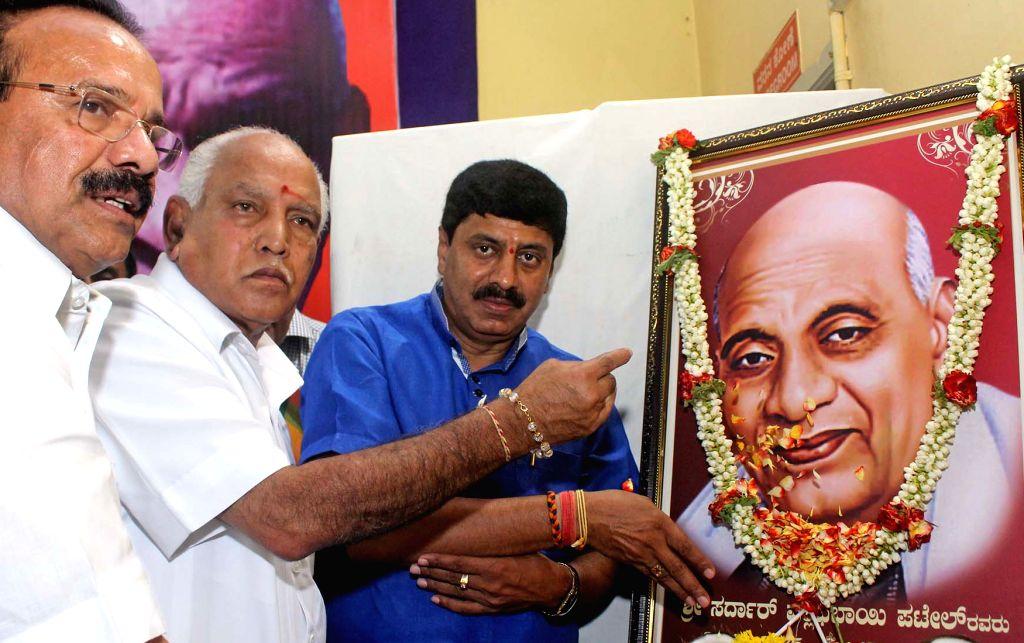 Union Minister for Statistics & Programme Implementation DV Sadananda Gowda and Karnataka BJP chief BS Yeddyurappa pay tribute to Sardar Vallabhbhai Patel on his birth anniversary in ... - Sardar Vallabhbhai Patel