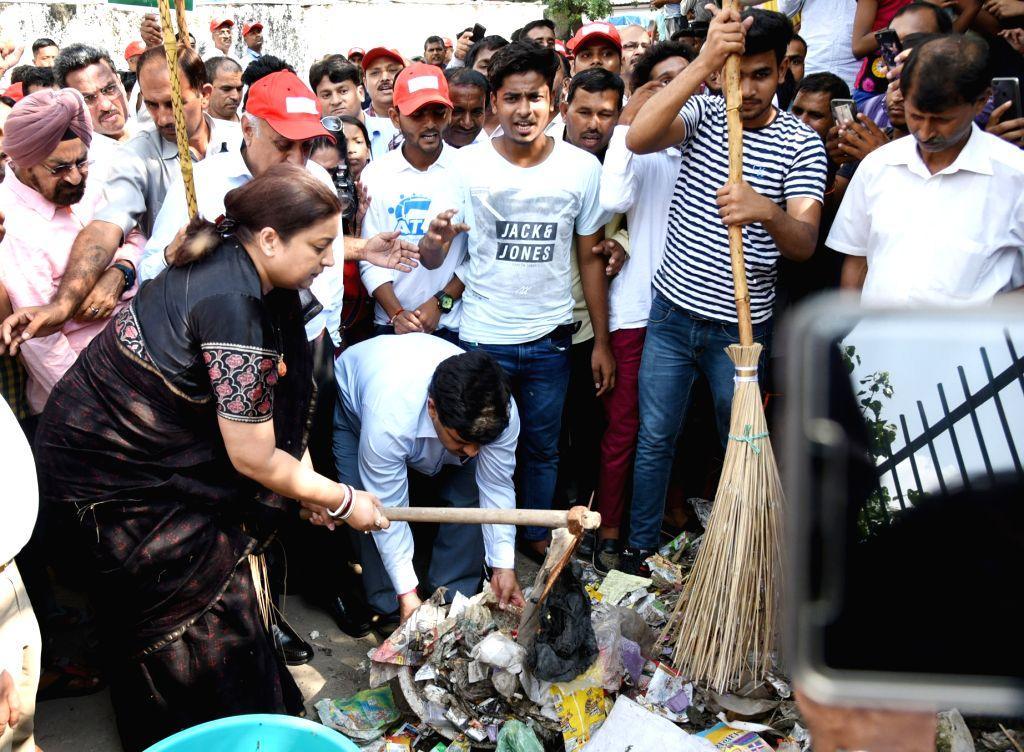 "Union Minister for Textiles Smriti Irani participats in cleanliness drive on the occasion of the ""Swachhata Hi Sewa"" Abhiyan, in New Delhi on Sept 15, 2018. - Smriti Irani"