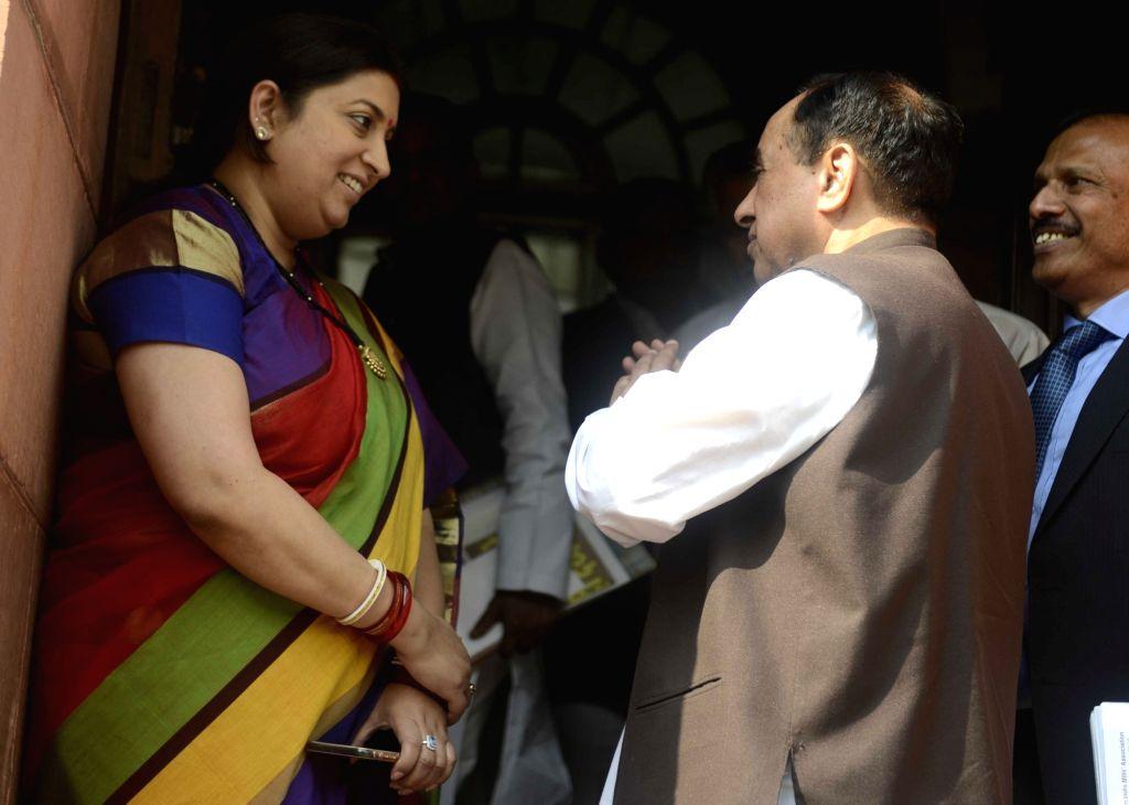 Union Minister for Textiles, Smriti Irani and BJP MP Subramanian Swamy at the Parliament in New Delhi on Nov 29, 2016. - Smriti Irani