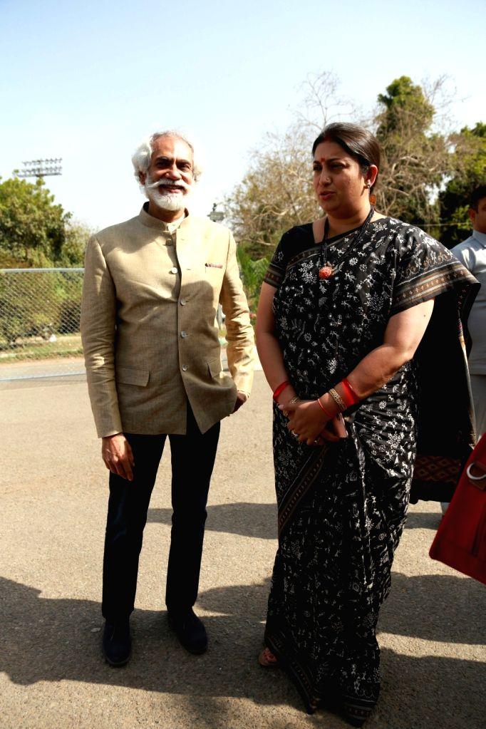 Union Minister for Textiles Smriti Irani and FDCI President Sunil Sethi arrive to attend the Amazon IndiaFashion Week, in New Delhi on March 15, 2017. - Smriti Irani
