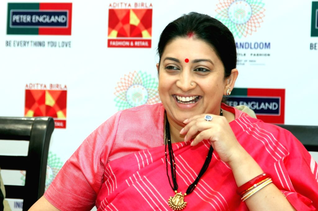 Union Minister for Textiles, Smriti Irani during the launch of new Handloom Collection for men of Peter England at a showroom in Connaught Place of New Delhi on Nov 28, 2016. - Smriti Irani