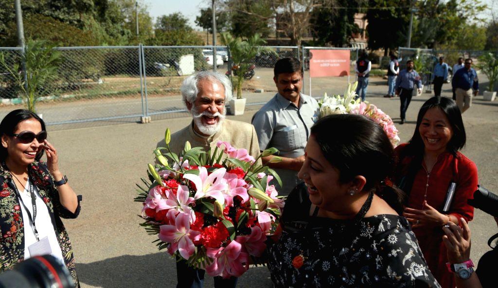 Union Minister for Textiles Smriti Irani, FDCI President Sunil Sethi and Fashion designer Anju Modi arrives to attend the Amazon India Fashion Week, in New Delhi on March 15, 2017. - Smriti Irani and Anju Modi