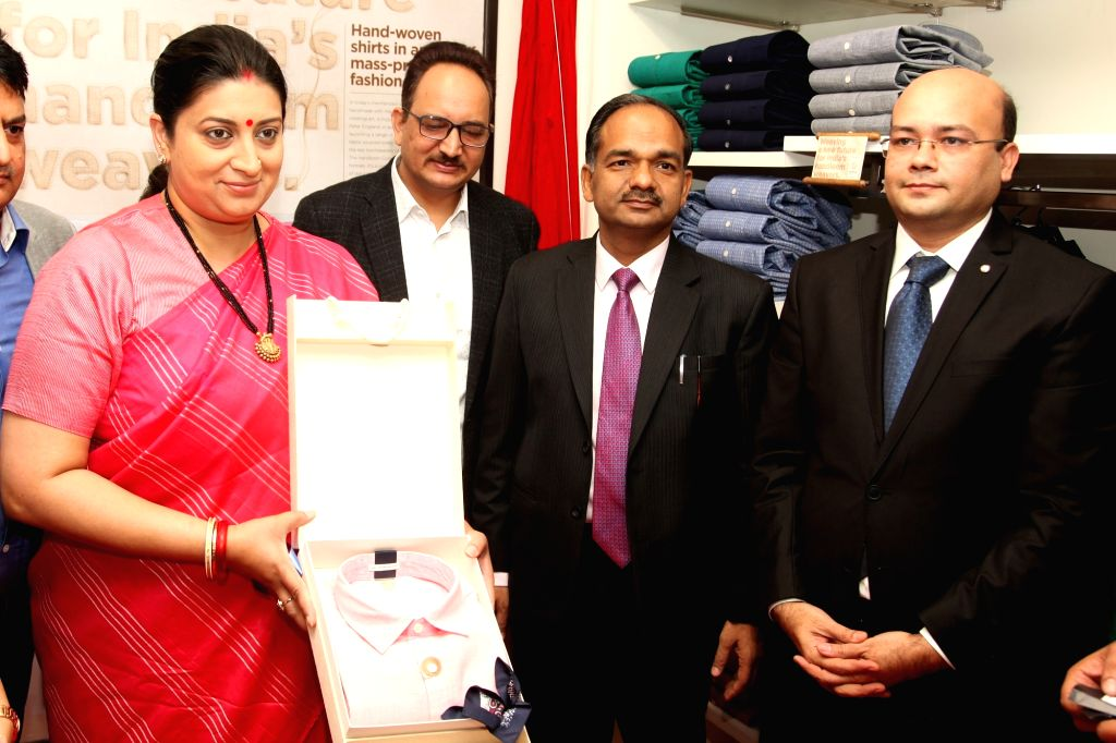Union Minister for Textiles, Smriti Irani, Peter England Brand Head Manish Singhai and Handlooms Development Commissioner Alok Kumar during the launch of new Handloom Collection for men of ... - Smriti Irani