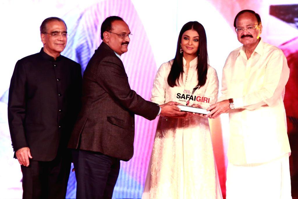 "Union Minister for Urban Development, Housing & Urban Poverty Alleviation and Information & Broadcasting M. Venkaiah Naidu and actress Aishwarya Rai during  ""India Today ... - Aishwarya Rai and M. Venkaiah Naidu"