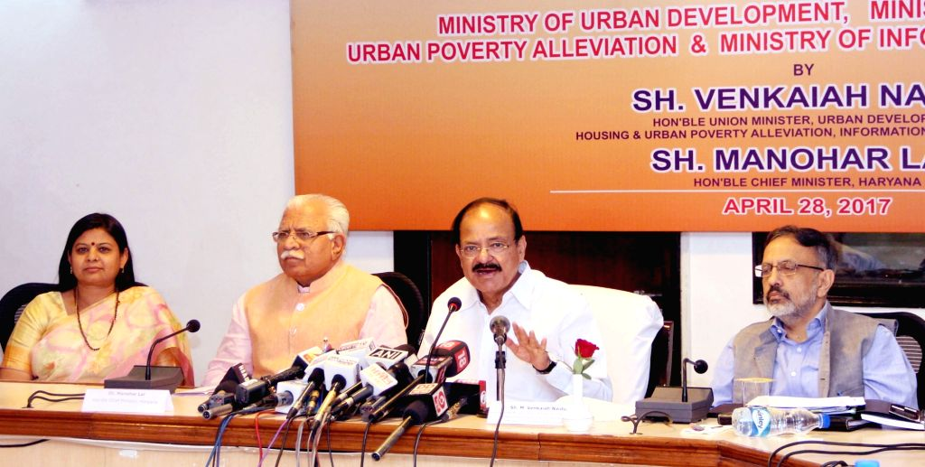 Union Minister for Urban Development, Housing & Urban Poverty Alleviation and Information & Broadcasting M Venkaiah Naidu at the meeting to review activities of I&B Field ... - Manohar Lal Khattar, M Venkaiah Naidu and Kavita Jain