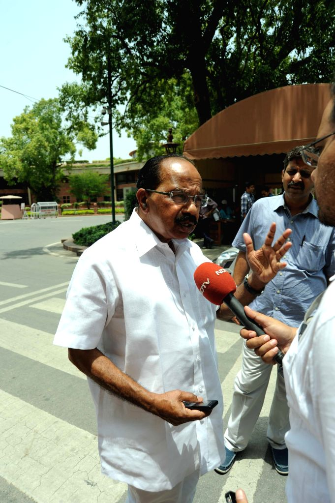 Union Minister for Urban Development, Housing and Urban Poverty Alleviation and Parliamentary Affairs M. Venkaiah Naidu talks to a journalist at the Parliament premises in New Delhi on July 7, 2014. - M. Venkaiah Naidu