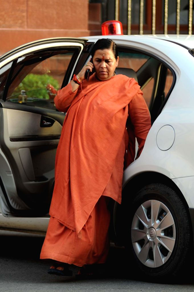 Union Minister for Water Resources, River Development and Ganga Rejuvenation Uma Bharati arrives at the Parliament in New Delhi on Aug 13, 2014.