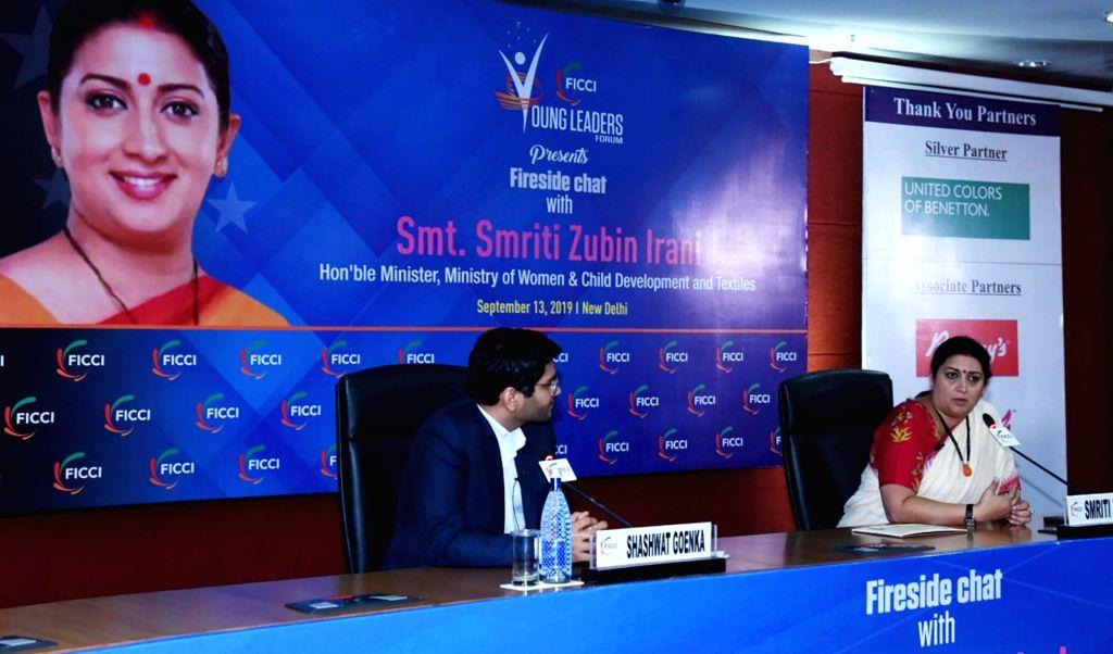 Union Minister for Women & Child Development and Textiles Smriti Irani addresses at the Fireside Chat function, in New Delhi on Sep 13, 2019. - Smriti Irani