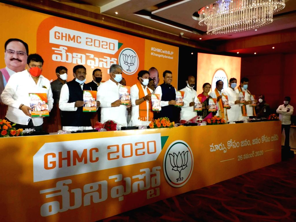 Union Minister G. Kishan Reddy and BJP leaders Bhupender Yadav and Devendra Fadnavis release the party manifesto for GHMC elections, in Hyderabad on Nov 26, 2020. - G. Kishan Reddy and Bhupender Yadav