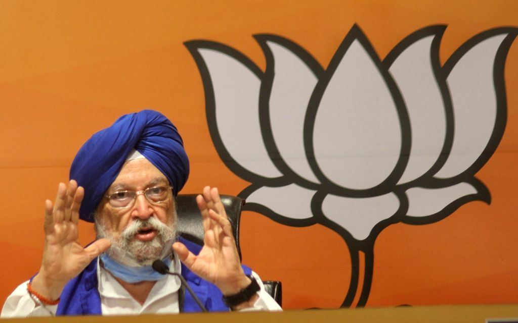 Union Minister Hardeep Singh Puri and Sambit Patra address a press conference at BJP HQ, 6A DDU Marg in New Delhi on Friday June 18, 2021. - Hardeep Singh Puri