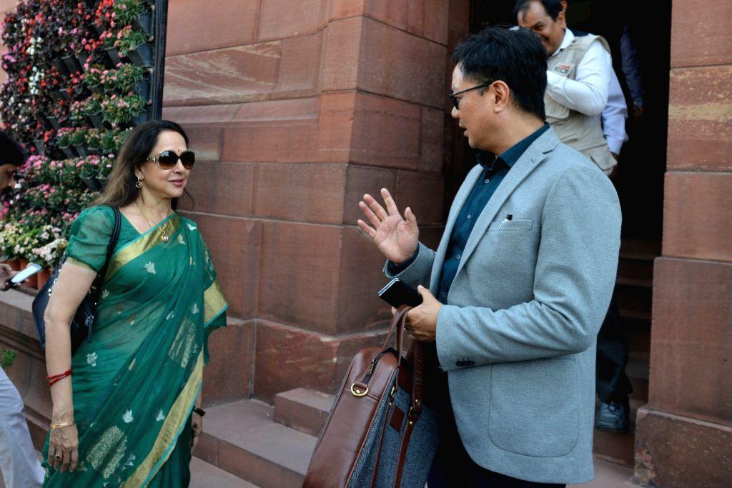 Union Minister Kiren Rijiju and BJP MP Hema Malini at Parliament in New Delhi on March 18, 2020. - Kiren Rijiju and Hema Malini