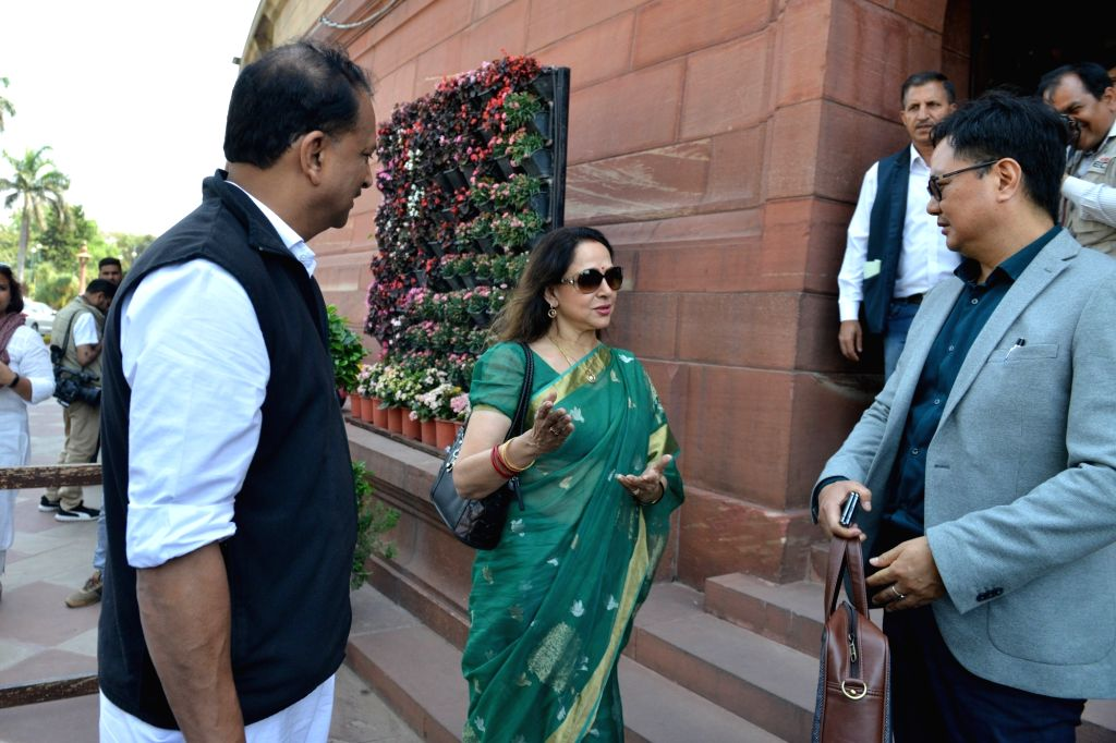 Union Minister Kiren Rijiju and BJP MPs Rajiv Pratap Rudy and Hema Malini at Parliament in New Delhi on March 18, 2020. - Kiren Rijiju and Hema Malini