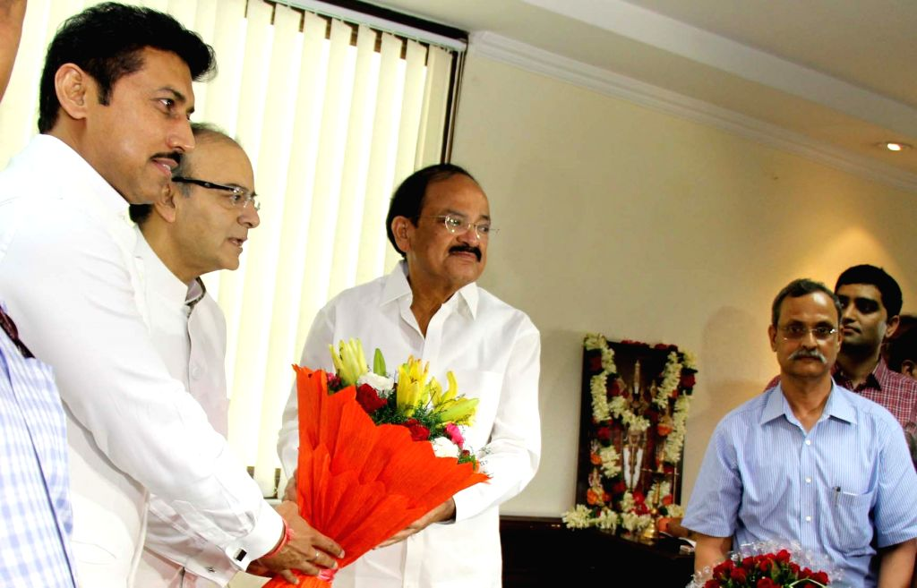 Union Minister M. Venkaiah Naidu being greeted by Union Minister for Finance and Corporate Affairs Arun Jaitley and Union MoS Information & Broadcasting Col. Rajyavardhan Singh as he ... - M. Venkaiah Naidu, Affairs Arun Jaitley and Rajyavardhan Singh