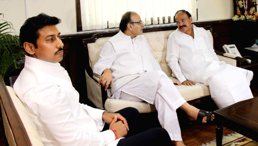 Union Minister M. Venkaiah Naidu with Union Minister for Finance and Corporate Affairs Arun Jaitley and Union MoS Information & Broadcasting Col. Rajyavardhan Singh as he assumes ... - M. Venkaiah Naidu, Affairs Arun Jaitley and Rajyavardhan Singh