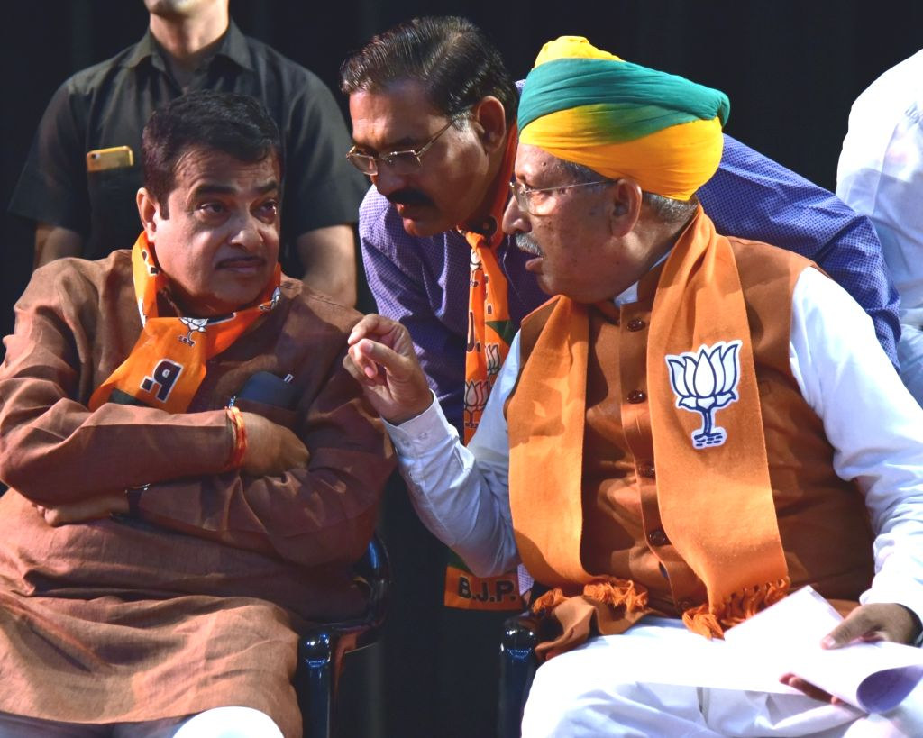 Union Minister Nitin Gadkari in a conversation with BJP's Lok Sabha candidate from Bikaner, Arjun Ram Meghwal during a public rally ahead of 2019 Lok Sabha elections, in Rajasthan's Bikaner, ... - Nitin Gadkari