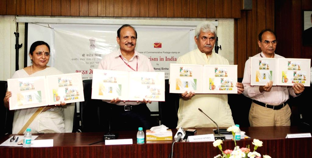 """Union Minister of State for Communications and Railways Manoj Sinha releases a Commemorative Postage Stamp on """"Tourism in India"""", in New Delhi on Aug 15, 2016. - Manoj Sinha"""