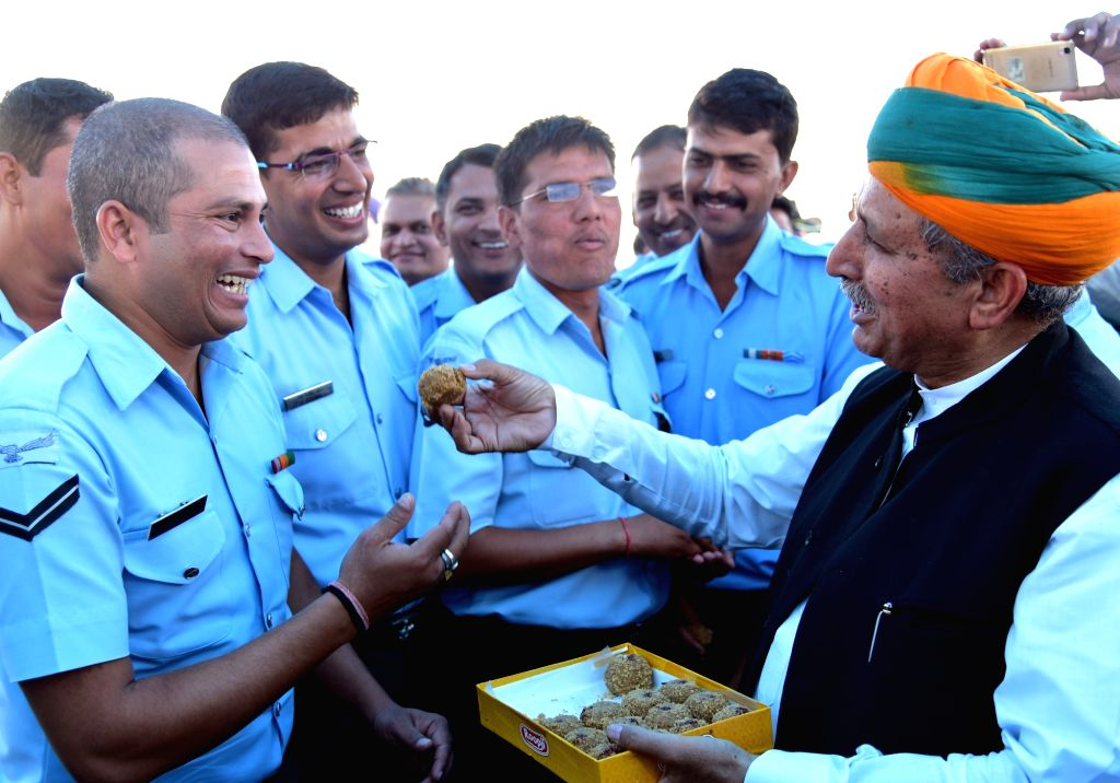 Union Minister of State for Finance and Corporate Affairs Arjun Ram Meghwal celebrates Diwali with air warriors in Bikaner on Oct 30, 2016.
