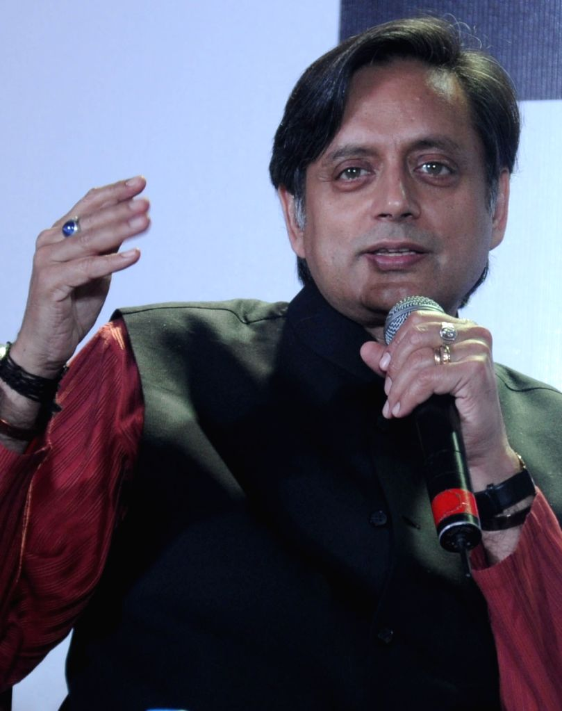 Union Minister of State for HRD Shashi Tharoor speaks during the Kolkata Literay Meet 2013 at Kolkata International Book Fair in Kolkata on Feb. 1. - Shashi Tharoor