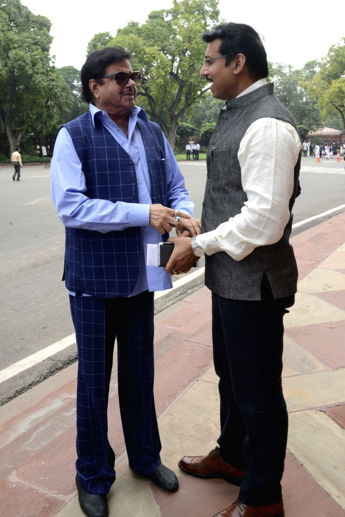 Union Minister of State for Information & Broadcasting, Col. Rajyavardhan Singh Rathore and BJP MP and actor Shatrughan Sinha at the Parliament in New Delhi, on Aug 10, 2015. - Shatrughan Sinha and Rajyavardhan Singh Rathore
