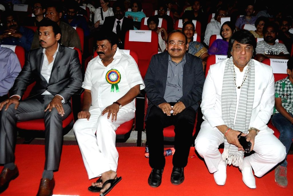 Union Minister of State for Information and Broadcasting Rajvardhan Singh Rathore and Mukesh Khanna  during the 19th The Golden Elephant International Children`s Film Festival (ICFFI) in ... - Rajvardhan Singh Rathore and Mukesh Khanna